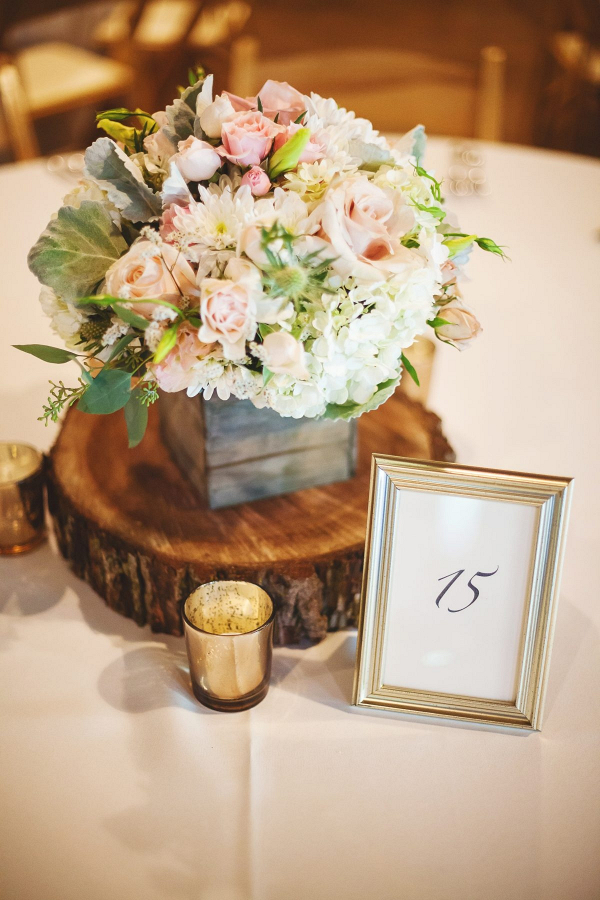 Rustic wedding centerpieces with wood slices