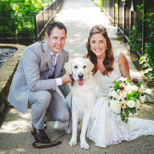 Bride and groom and dog wedding portrait