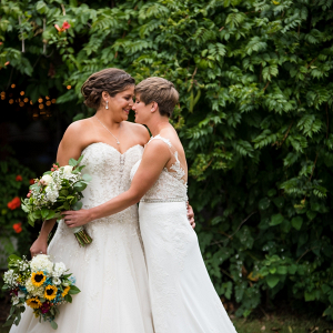 Two brides with sunflower bouquets
