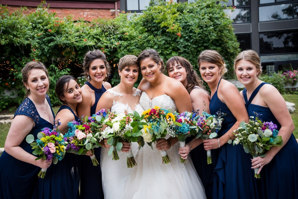 Bridal party with colorful rustic bouquets