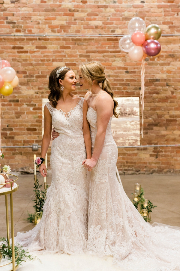 Same sex wedding with brides in lace dresses