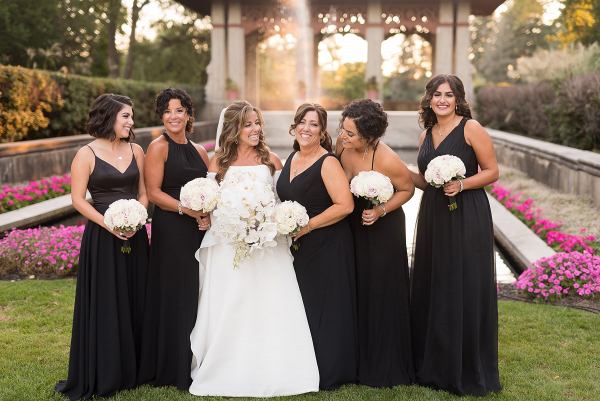 Bridesmaids in long black gowns