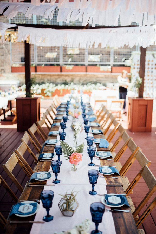 Long table reception with geometric marble place cards