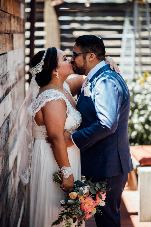 Bride in lace wedding dress with groom