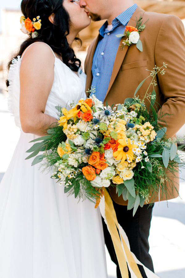 Vibrant yellow and orange bridal bouquet