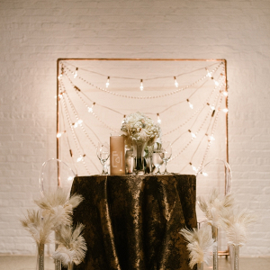Art Deco vintage sweetheart table with feathers and beads