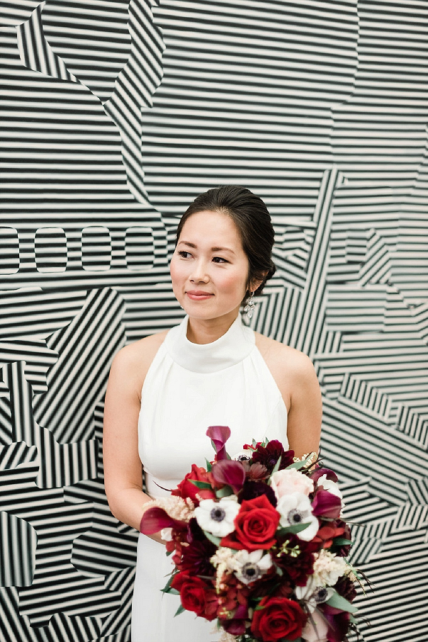 Chicago bride with bright red and purple bouquet