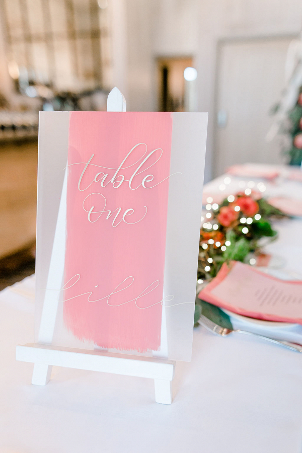 Coral table name on acrylic with gold calligraphy