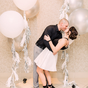 Tassel balloon engagement portrait