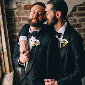 Grooms in black tuxes