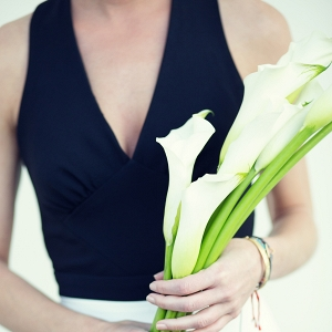 Black and white bridesmaid dress with calla lily bouquet