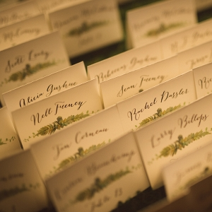 Calligraphy escort cards with botanical prints