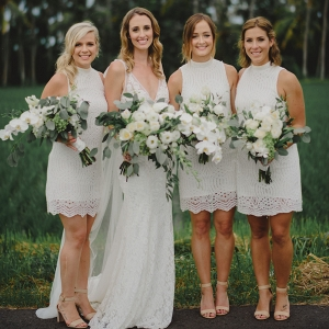 white-bridsemaids-dresses-and-floral-bouquets