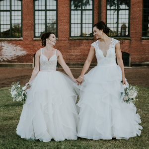 Brides in layered tulle gowns