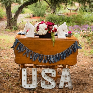 Sweetheart table with denim details and ceramic horse heads