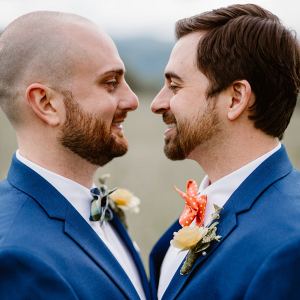Grooms in blue suits