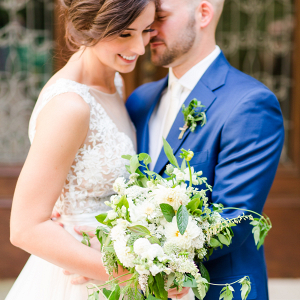 Bride and groom with lush bouquet