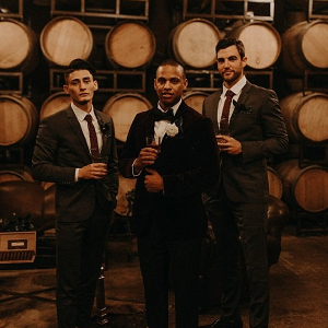Dapper groomsmen in winery