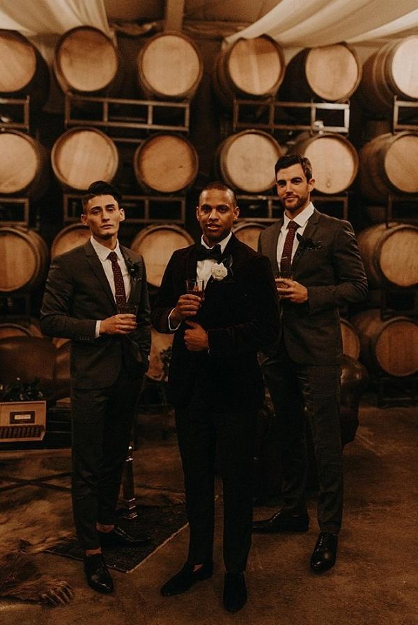 Dapper groomsmen in winery
