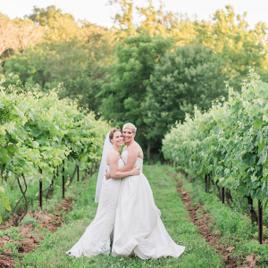 Brides in vineyard