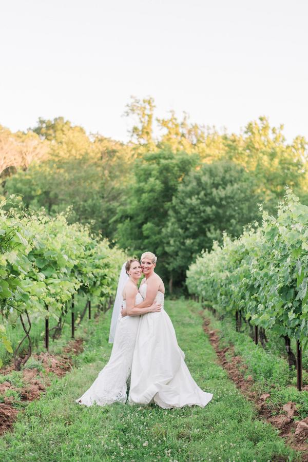 Brides in vineyard