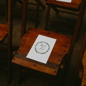 Wooden Ceremony Seating with Illustrated Programs