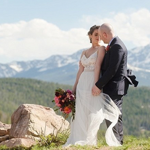 Bride and groom on mountainside