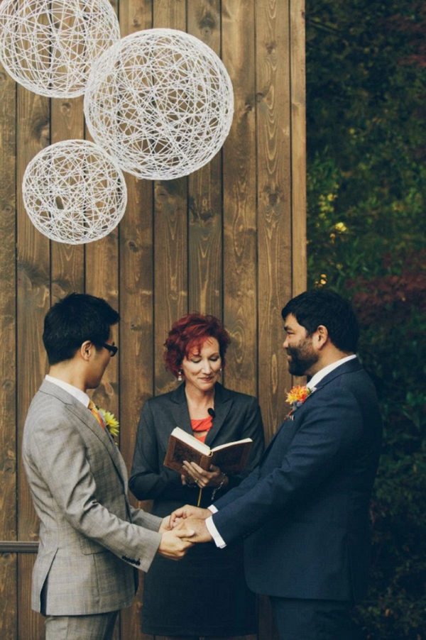 Wooden Ceremony with Geometric Installation Backdrop