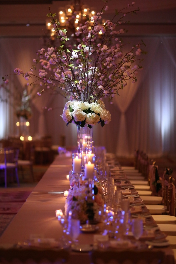 Blush Pink and White Floral Wedding Reception Centerpieces with Cherry Blossom Branches with Candlelight at Long Feasting Table | Sarasota Wedding Venue Ritz Carlton
