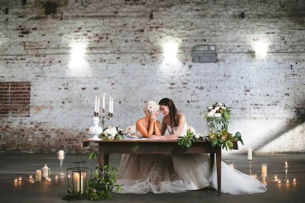 Same Sex Gay Couple at Vintage Wooden Sweetheart Table at Wedding Reception, Surrounded by Candlelight and Flowers Bohemian/Boho Styled Wedding Shoot