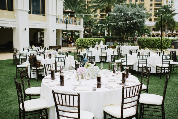 Black Chivari Chairs with Pastel Wedding Centerpieces | Outdoor Cafe Lighting Detail at Clearwater Beach Wedding Venue Sandpearl Resort