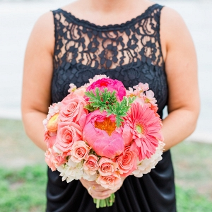 Bridesmaid in Navy Blue Bridesmaids Dress and Bright Coral and Pink Wedding Bouquet of Flowers