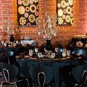 St. Pete Wedding Reception Table Decor with Wooden Twigs in Black Vase Centerpieces with Candles | Black and Chrome Wedding Reception Chairs