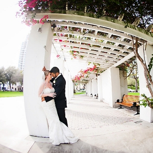 Wedding Portrait of Bride and Groom Under Lattice Portico with Ivy and Trellis in Downtown Florida Park