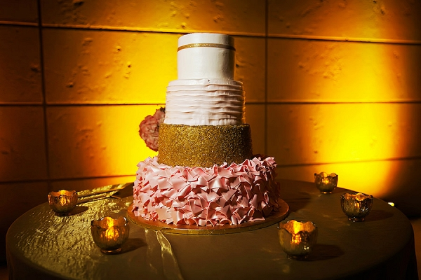 Four-Tiered White Gold and Blush Wedding Cake with Blush Pink Ruffled Detail and Unique Accents