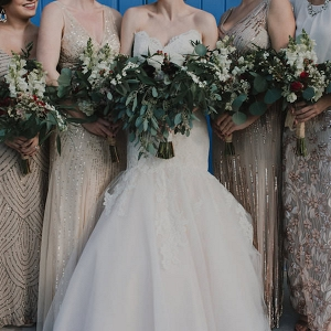 Bridal Party Wedding Portrait with Gold Sequined Mis-Matched Bridesmaids Dresses and Strapless JLM Couture Wedding Dress with Green and Ivory Floral Bouquets
