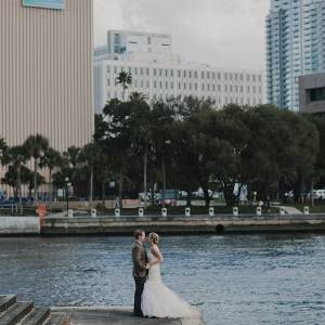 Outdoor, Downtown Florida Waterfront Bride and Groom Wedding Portrait in Tan Suit and Ivory, Strapless JLM Couture Wedding Dress