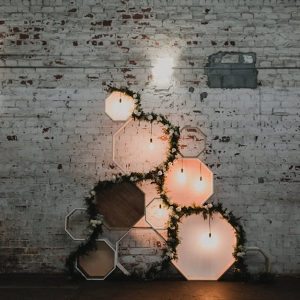 Wedding Reception Wall Decor with Wooden Geometric Shaped and Lights | Downtown Tampa Wedding Venue The Rialto