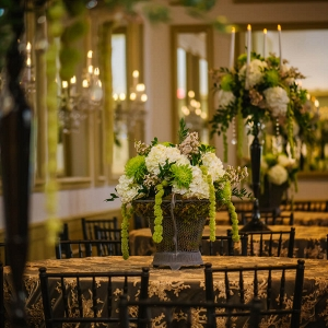 Cascading White and Green Hydrangea and Spider Flower Wedding Centerpiece in Dark Bronze Vase on Embroidered Gold Tablecloths