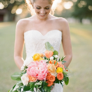 Florida Bride in Sweetheart Wedding Dress with Orange, Yellow and Pink Wedding Bouquet