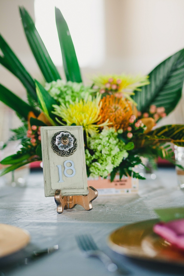Wedding Reception Table Decor with Vintage Door Table Numbers, Cigar Boxes and Orange and Yellow Flower Centerpieces