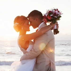 Beach, Waterfront Sunset Bride and Groom Wedding Portrait