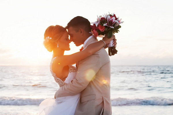 Beach, Waterfront Sunset Bride and Groom Wedding Portrait