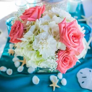Beach Wedding Reception Decor | Blue, Green, Teal, Ivory and Pink Flower Centerpieces and Tealights and Starfish