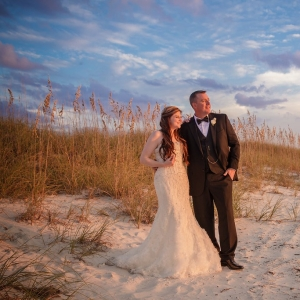 Destination Beach Bride and Groom Wedding Portrait at Sunset | Outdoor St Pete Beach Wedding at Loews Don CeSar | Kleinfeld Bridal Strapless Bea…