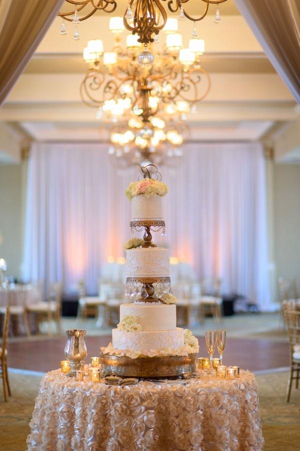 Elegant 4-Tier Round White Wedding Cake with Flowers
