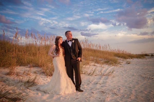 Destination Beach Bride and Groom Wedding Portrait at Sunset | Outdoor St Pete Beach Wedding at Loews Don CeSar | Kleinfeld Bridal Strapless Bea…