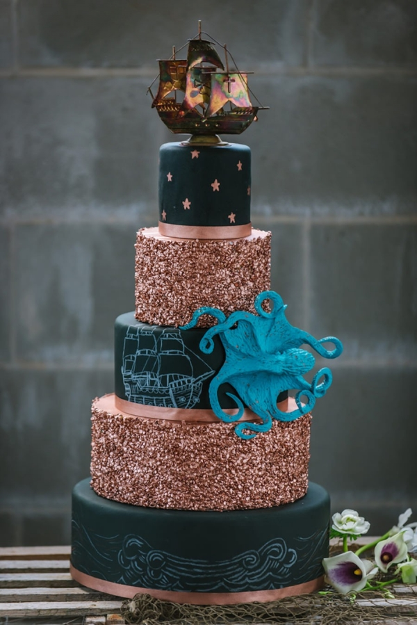 Black and Gold 5 Tiered Nautical Inspired Wedding Cake with Pirate Ship and Octopus Details