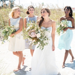 Florida Coastal Chic Wedding Portrait, Bride with Bridesmaid in Dessy Bridal Gowns at Beach Wedding