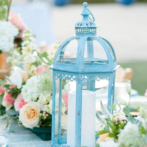 Outdoor, St. Petersburg Wedding Reception Table Decor with Wooden Chairs, Blue Table Linens, and Peach and Ivory Floral Wedding Centerpieces and Blue Lanterns